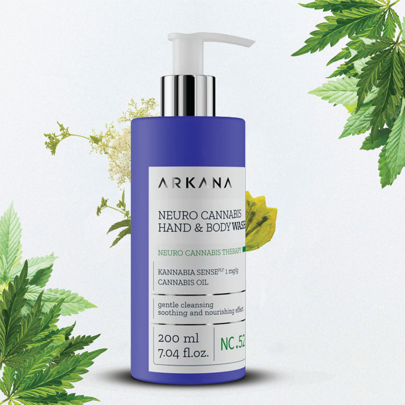 "Tall navy blue 200 ml bottle with white pump. Black text on light grey label reading, ""Arkana - Neuro Cannabis Hand & Body Washing. Kannabia Senseplf 1 mg/g Cannabis Oil. Gentle Cleansing, soothing and nourishing effect. 200 ml, 7.04 fl.oz.. Part of Neuro Cannabis Therapy. Hemp leaves and white flowers flourishing in the background."