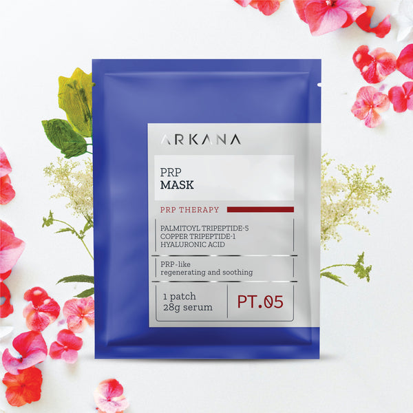 Navy Blue pouch labelled PRP Mask, part of PRP Therapy Line. Listed text: Palmitoyl Tripetide-5, Copper Tripetide-1, hyaluronic Acid, PRP-like, regenerating and soothing. 1 patch, 28 g serum. PT. 05. Item in front of white baby breath with red flowers scattered at top right hand and bottom left hand corner, in off white background.