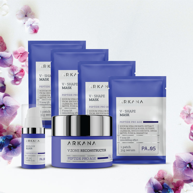Four blue pouches labeled as V Shape Mask laid out diagonally behind a shallow cylinder navy blue bottle labelled as V Zone Reconstructor, and a slim tall navy blue bottle labelled as Bo2Look Elixir with white nozzle and clear cap. All items are placed in off white backdrop with purple flowers scattered on the left hand side and bottom right hand corner. This Pro-Age Special Gift set for Anti-Aging treatment.