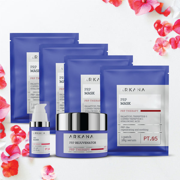 Four blue pouches labeled as PRP Masks laid out together behind a shallow cylinder navy blue bottle labelled as PRP Rejuvenator, and a slim tall navy blue bottle labelled as PRP Elixir. All items are placed in plain white backdrop with pink florals decorated in the top right hand corner and bottom left hand corner. This is PRP Special Gift set for Anti-Aging treatment.