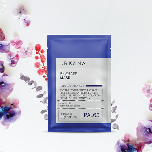 Blue pouch labeled as V -Shape Mask with purple and pink florals showcased in the background. Product produced by Arkana Neuro Cosmetics. Part of Peptide Pro Age line which focuses on anti-aging effects. V-Shape Mask focuses on face contouring and remodelling skin.