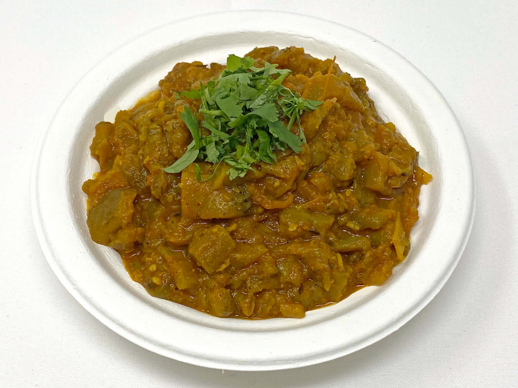 Roasted and mashed eggplant curry