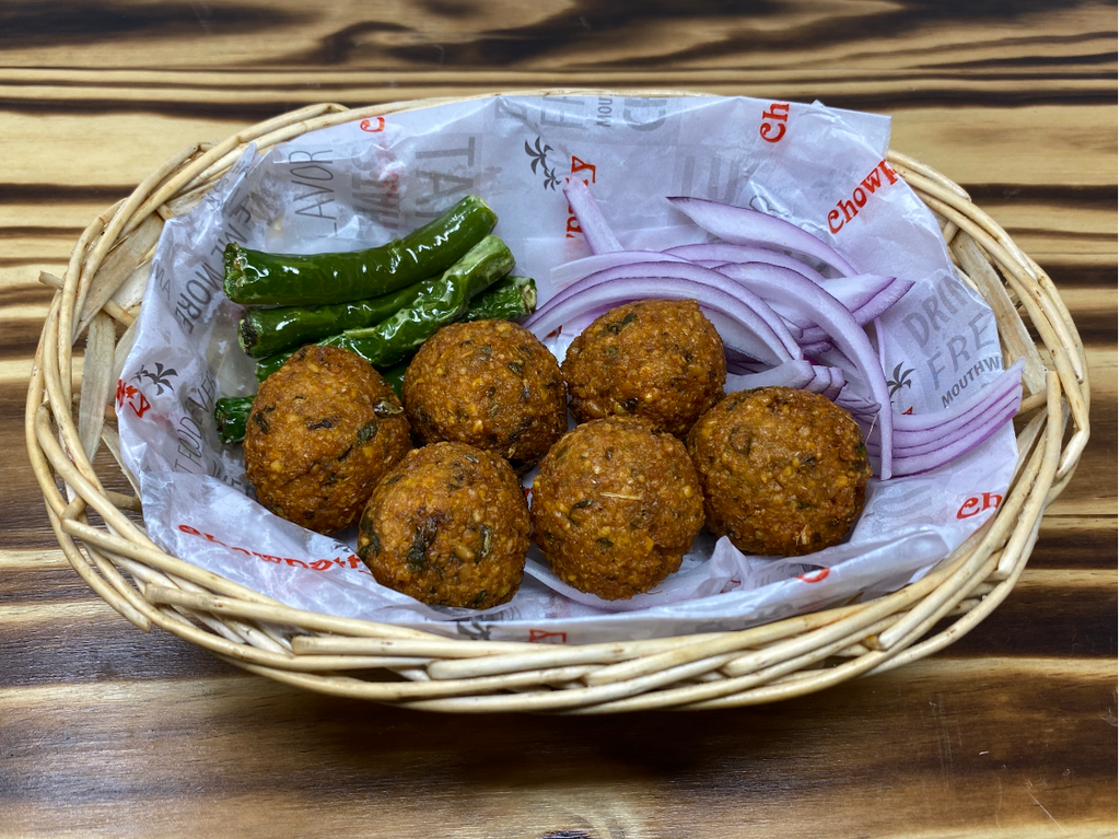 Deep-fried Lentil (Moong Dal) fritters served with onions and chilies