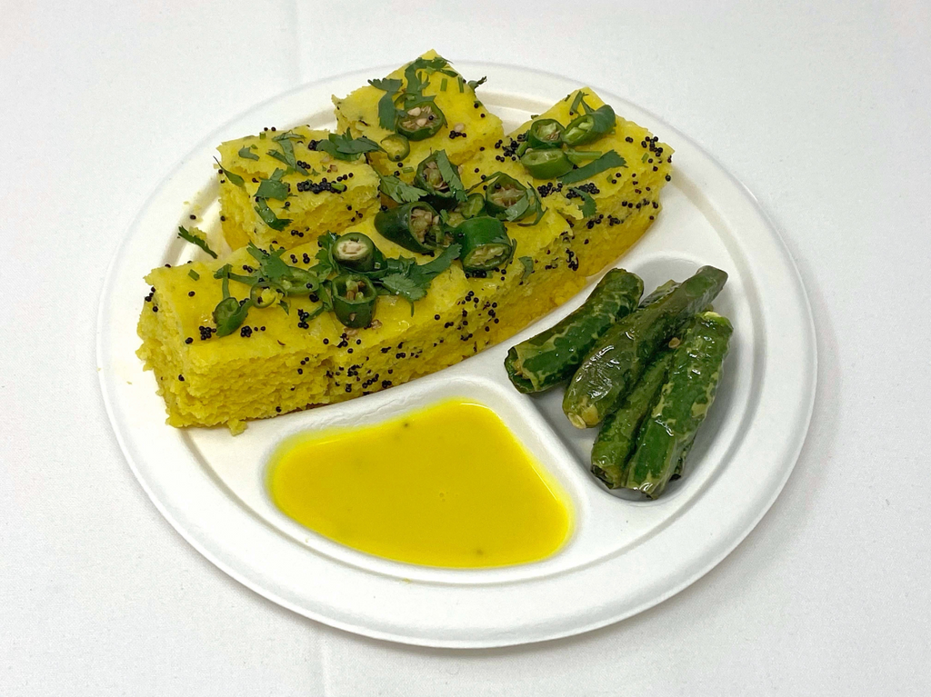 Steamed chickpea flour sponge cakes tempered with mustard seeds and green chilies