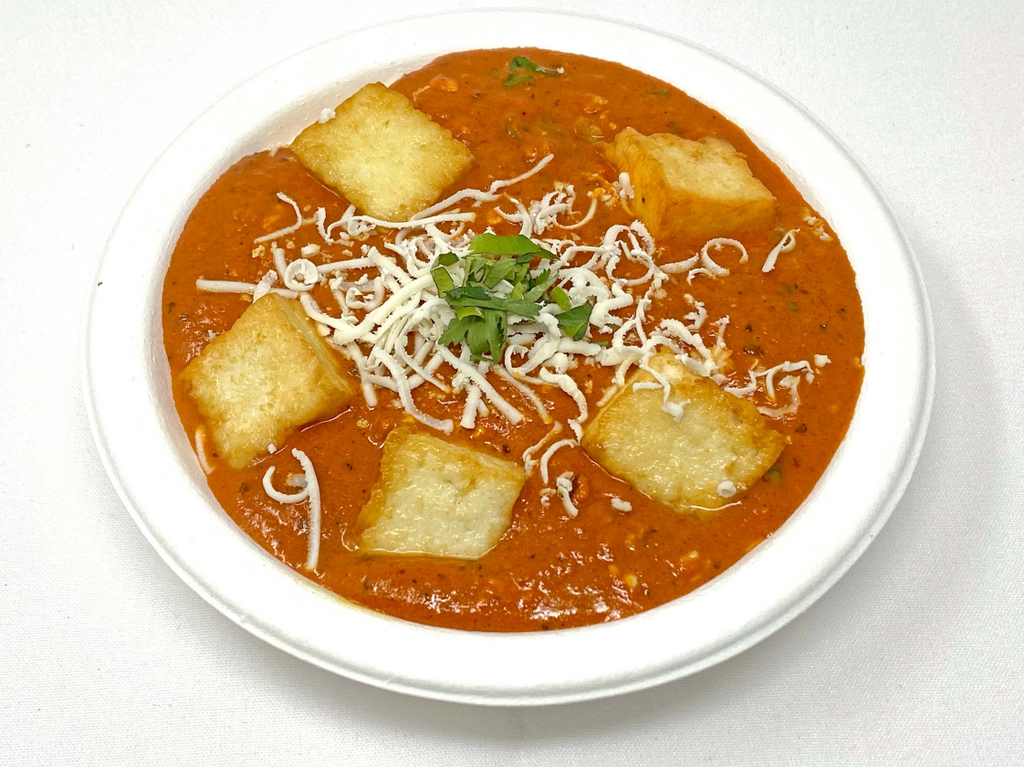 Tomato, cashews, spices and cream gravy with paneer cubes
