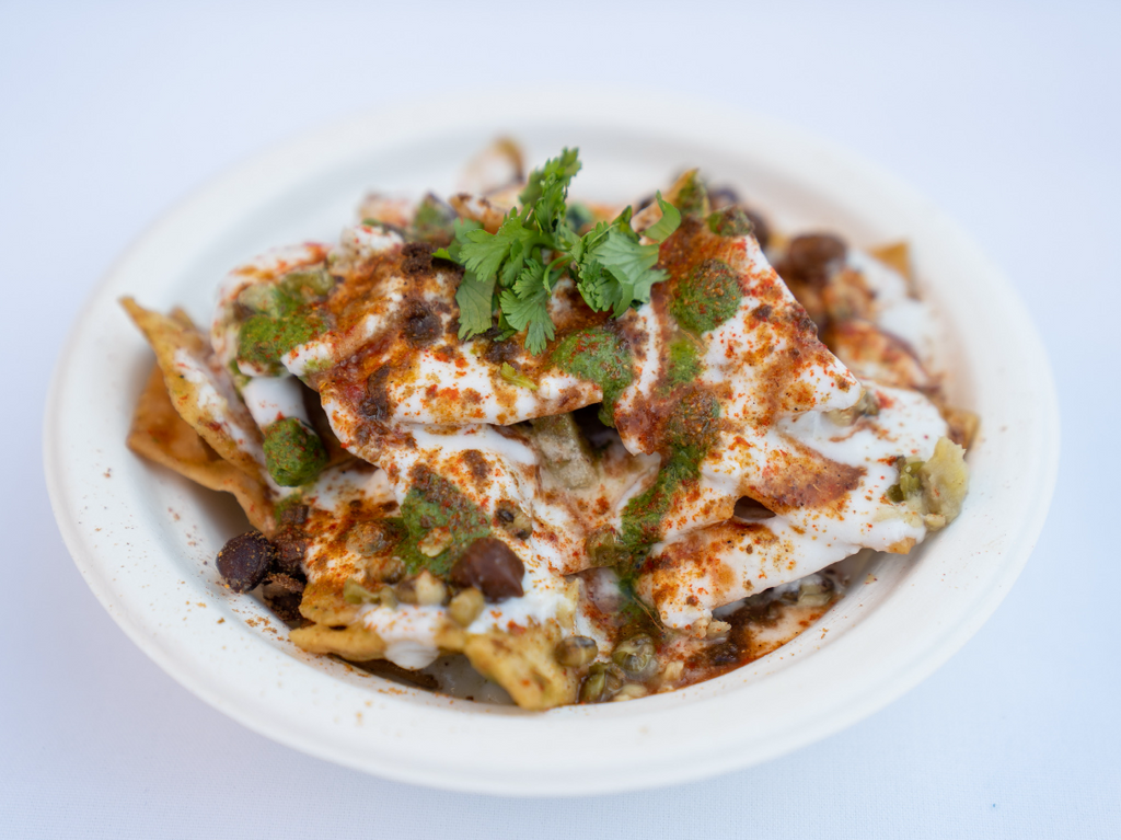 Flat flour chips tossed with potatoes, black channa, moong, sweet and hot chutney topped with yogurt and chaat masala