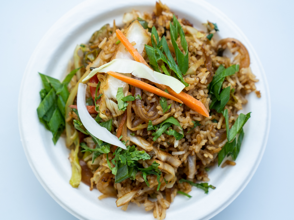 Fried rice sauteed with our soy sauce mix, carrots, onions, and cabbage topped with green onions