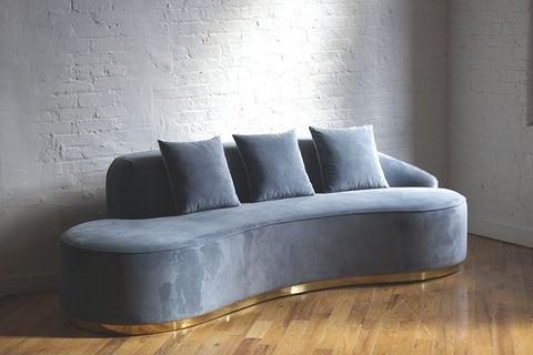Modern blue gray velvet Infinity sofa with brass colored base and pillows
