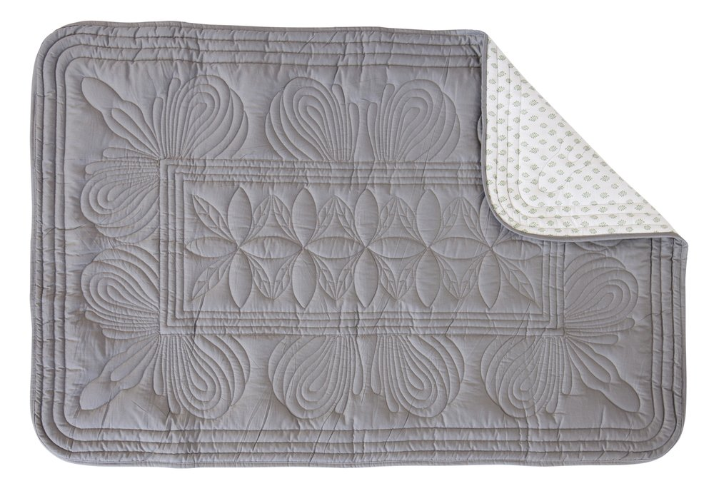 Bon Mere baby cot quilt. The back of the quilt with grey quilted pattern.