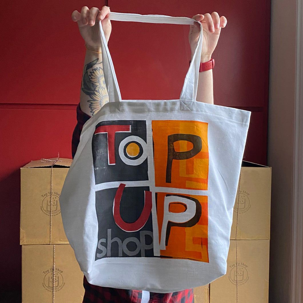 Handmade and hand-printed Top Up Shop tote bags