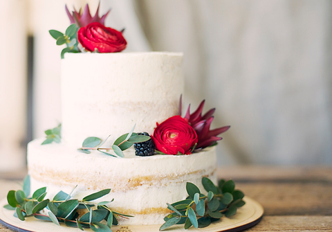 Cake designed with red preserved roses
