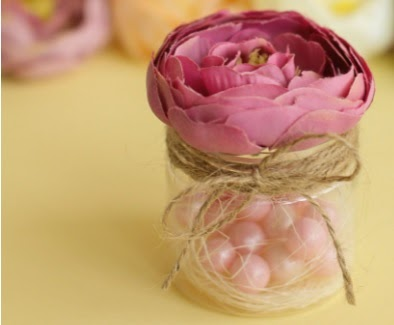 pink rose in a candy jar with jute twine