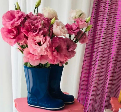 pink roses in an old pair of boots