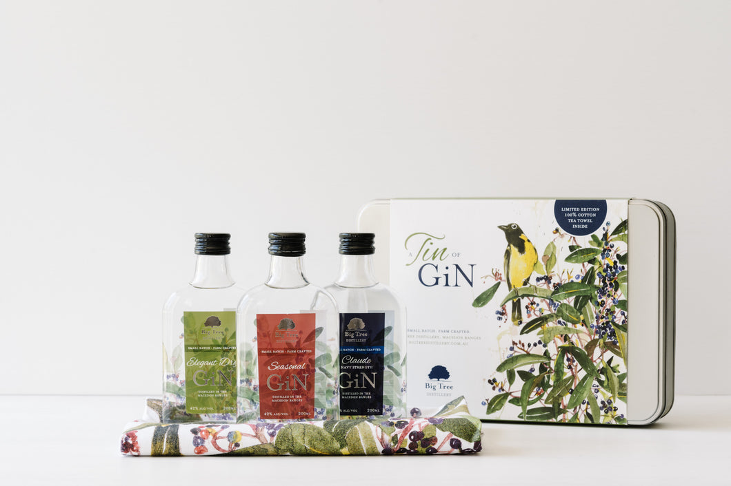 Our Tin of Gin product consisting of three 200ml bottles of gin and a tea towel