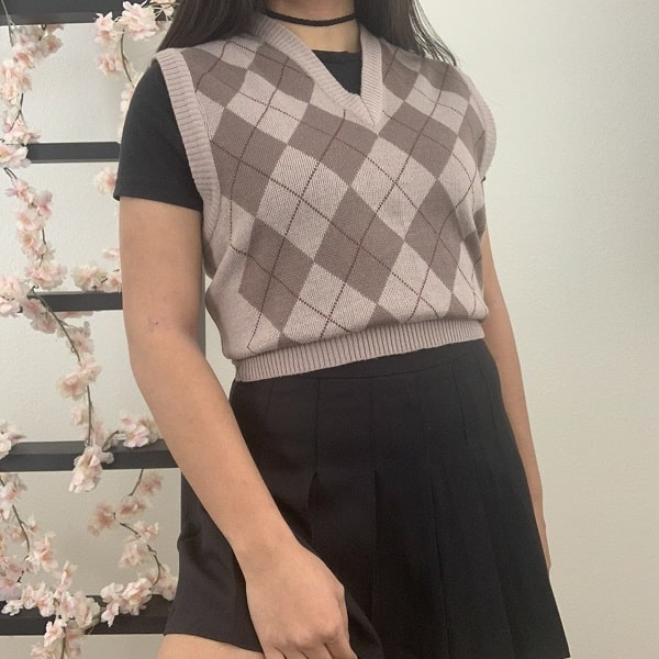 Argyle sweater vest paired with a black pleated skirt