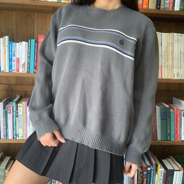 Vintage striped crewneck sweatshirt paired with a black pleated skirt