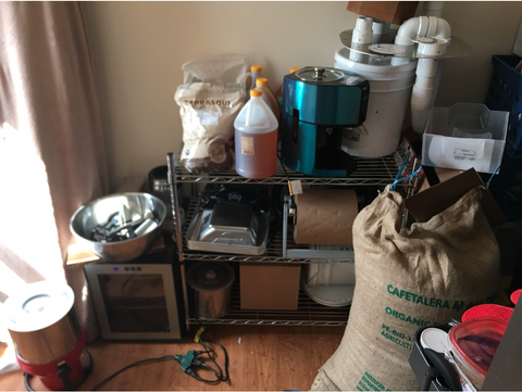 Supplies in a dorm closet that were used to make Honeymoon Chocolates, such as cacao pods and a grinder