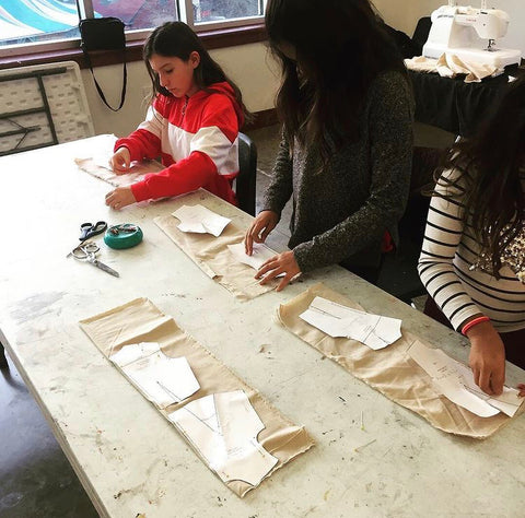 UNITY FASHION INSTITUTE FASHION DESIGN CLASS STUDENTS CUTTING OUT THERE SAMPLE GARMENT