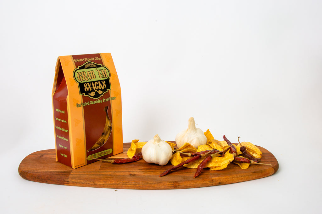 Gable-top box with a cut-out displaying delicious Chili Garlic strips with organic herbs/spices, sea-salt