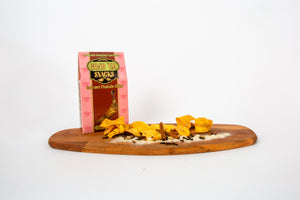 Gable-top box with a cut-out displaying delicious plantain chips/strips with organic herbs/spices, sea-salt