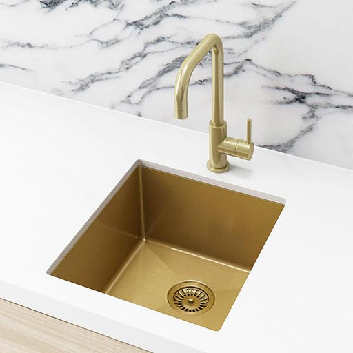 Meir Single Bowl PVD Kitchen Sink 440mm - Brushed Bronze Gold Featured in a Kitchen on a White Benchtop with a Marble Splashback| Bathroom Warehouse
