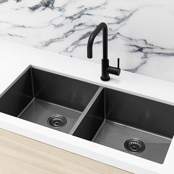 Meir Single Bowl PVD Kitchen Sink 860mm - Brushed Gun Metal Featured on a White Kitchen Benchtop and Marble Splashback with a Squared off Sink Mixer | Bathroom Warehouse