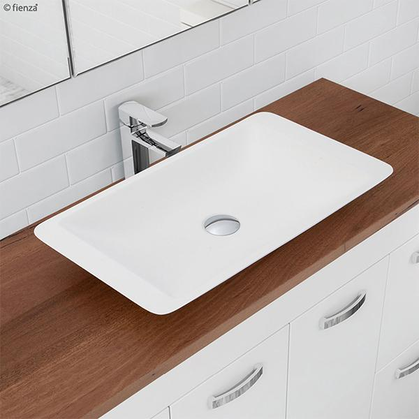 Fienza Classique 620 Above Counter Solid Surface Basin - Matte White on a wooden benchtop vanity with a chrome tap