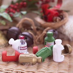Vial Safe insulin covers in dark green red white and gold placed with holiday  background