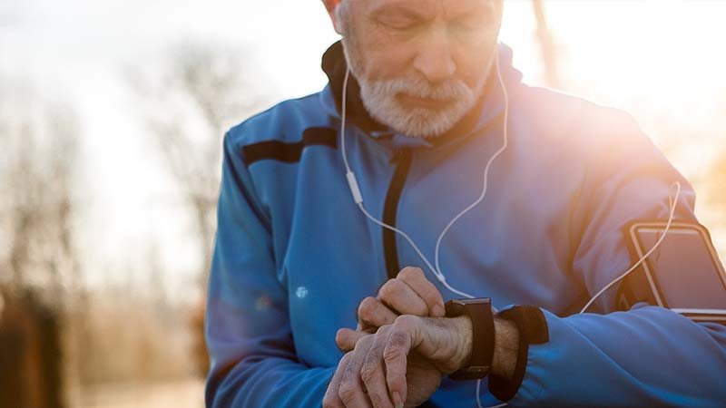 Artisan Coffee Co Health Benefits protection from stroke and heart disease man running checking heart rate headphones