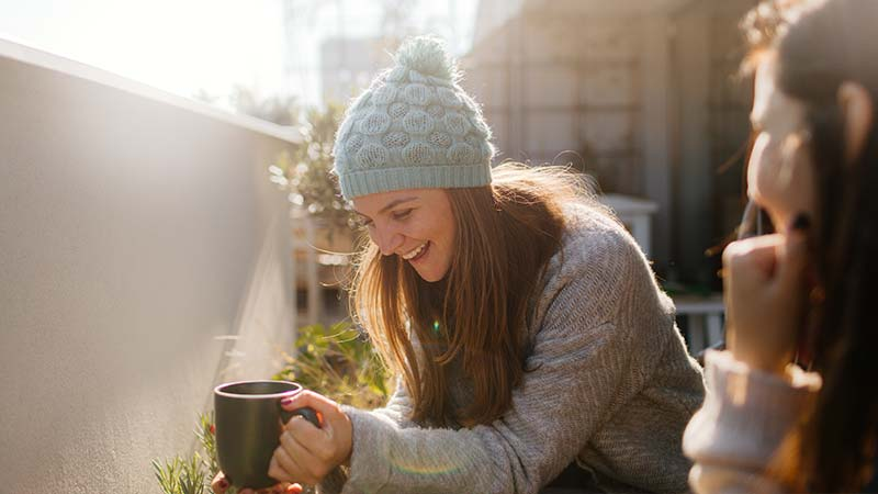 Artisan Coffee Co Health Benefits May Improve your mood and fight depression woman cup wolly hat smile