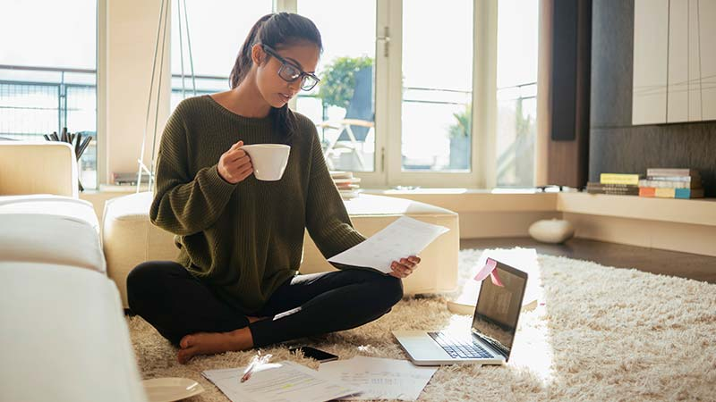 Artisan Coffee Co Health Benefits essential micronutrients woman working drinking cup laptop surrounded by work stimulant