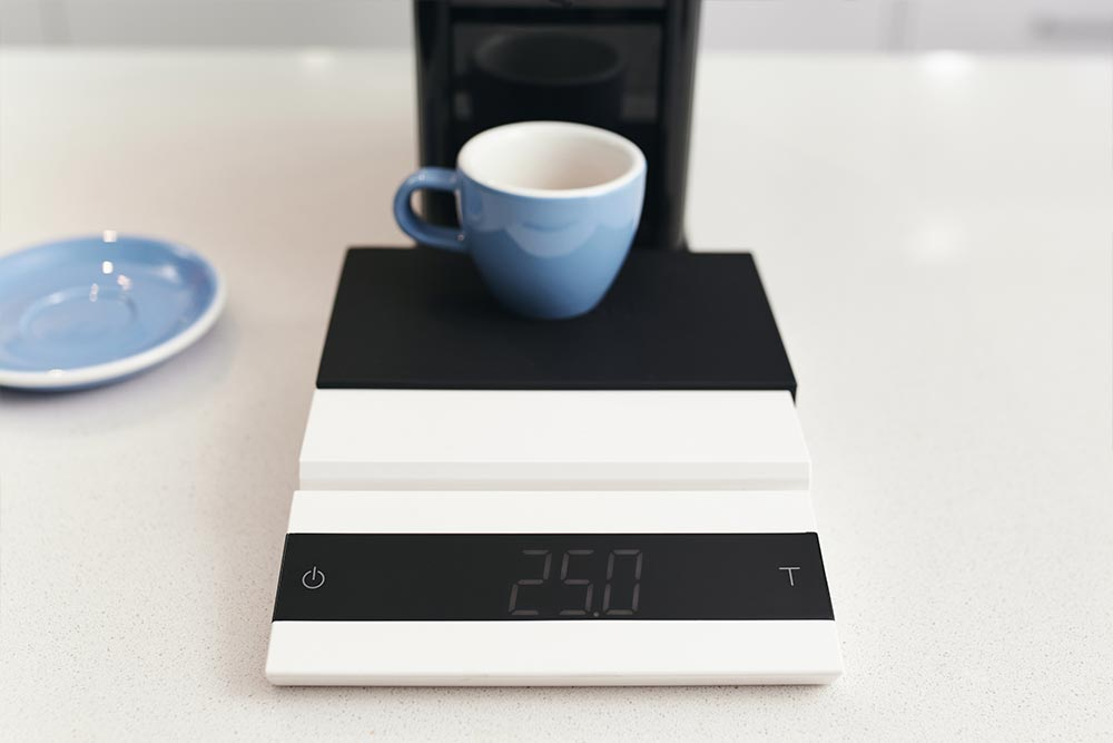 Artisan-coffee-co-pod-machine-callibration-care-guide-pour-reprogrammed-blue-cup-scales