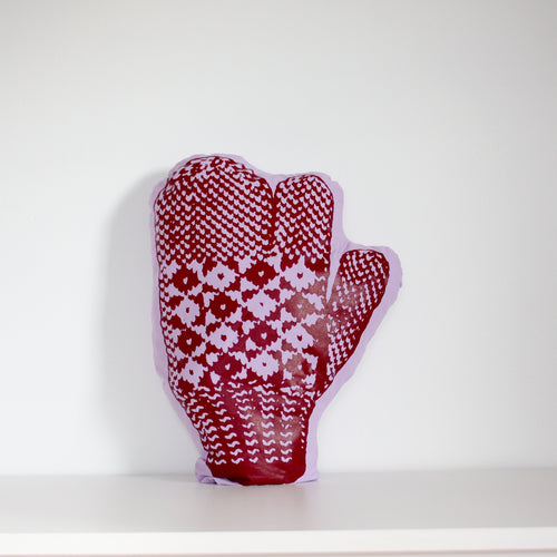 Purple trigger mitten pillow with red print.