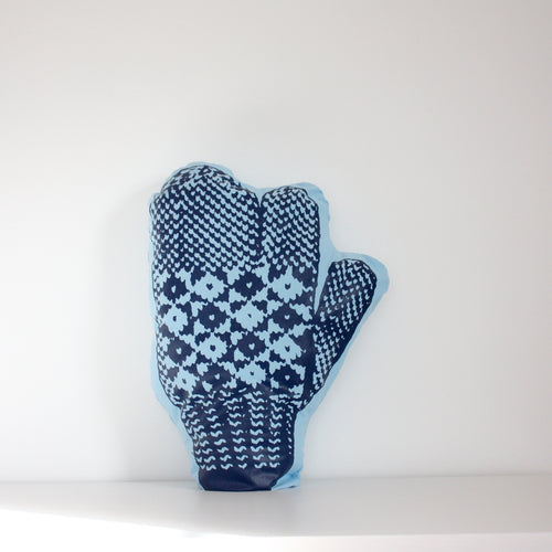 Light blue trigger mitten pillow with dark blue print.