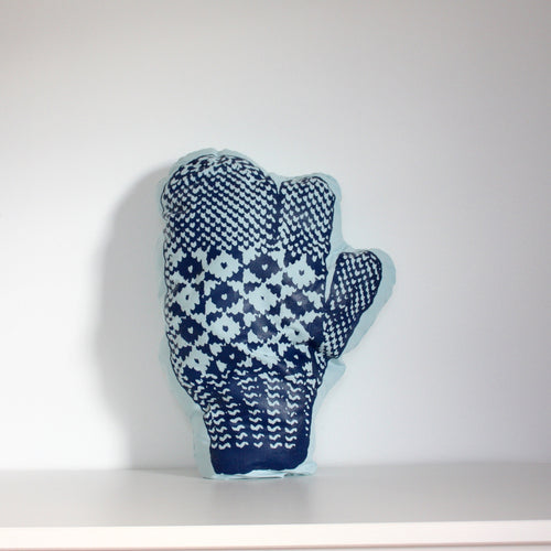 Aqua trigger mitten pillow with dark blue print.