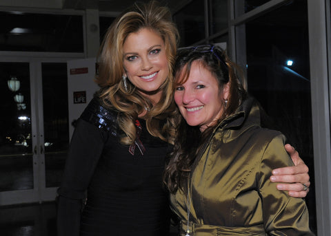I was given tickets to The Gift for Life Fundraiser last weekend while in New York. Super Model Kathy Ireland was at the party too--I just happened to be walking out behind her with a photographer and voila! Here's what happened! She's BEEEAAAUUti-ful. And very nice! I think I look terrified!