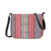 Online shopping for Mlavi Studio's whimsical vegan crossbody bag with Bohemian style Balkan textile pattern print. It's roomy enough to hold wallet, smart phone and small personal items like key and lip balm. Wholesale at www.mlavi.com for gift shops, fashion accessories & clothing boutiques, museum stores worldwide.