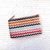 Shop Mlavi's beautiful Mexican textile pattern print small pouch/coin purse made with Eco-friendly & cruelty free vegan materials. Gift shop & boutique buyer can order wholesale at www.mlavi.com for ethically made & unique fashion accessories including bags, wallets, coin purses, pouches, travel accessories & gifts.