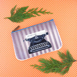Shop Mlavi studio's cool retro typewriter print vegan small pouch/coin purse made with SGS tested toxic-free Eco-friendly cruelty free vegan materials. Wholesale available at www.mlavi.com for gift shop, fashion accessories & clothing boutique in Canada, USA & worldwide.