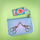 Shop Mlavi's cool retro sewing machine & scissor print vegan small pouch/coin purse made with SGS tested toxic-free Eco-friendly cruelty free vegan materials. Wholesale available at www.mlavi.com for gift shop, fashion accessories & clothing boutique in Canada, USA & worldwide.