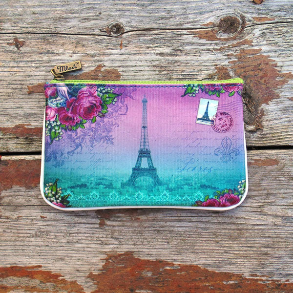 Shop Mlavi vintage style Paris Eiffel tower & Macaron vegan small pouch/coin purse made with durable, Eco-friendly vegan materials. It will add personality & glamour to your trip!  Mlavi wholesales Paris themed vegan bags, wallets, cardholders, luggage tags & pouches to gift shops, fashion accessories & clothing boutiques.