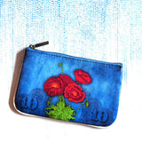 Shop Mlavi Studio's Eco-friendly vegan leather small pouch/coin purse with Poppy flower & Ukrainian embroidery pattern print. It's great for everyday use & a unique gift for yourself & family & friends. More Ukraine themed bags, wallets & other fashion accessories are available for wholesale at www.mlavi.com for gift shop & boutique buyers worldwide.