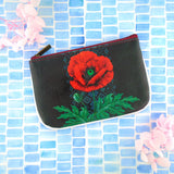 Shop Mlavi Studio's Eco-friendly vegan leather small pouch/coin purse with Ukrainian poppy flower & embroidery pattern print. It's great for everyday use & a unique gift for yourself & family & friends. More Ukraine themed bags, wallets & other fashion accessories are available for wholesale at www.mlavi.com for gift shop & boutique buyers worldwide.