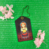 Shop Mlavi Studio's vegan leather luggage tag for women with Nesting doll Ukrainian girl print. Great for everyday use & a unique gift for yourself & family & friends. More Ukraine themed bags, wallets & other fashion accessories are available for