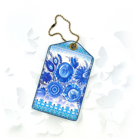 Shop Mlavi Studio's vegan leather luggage tag for women with Ukrainian Petrykivka style flower print. Great for everyday use & a unique gift for yourself & family & friends. More Ukraine themed bags, wallets & other fashion accessories are available for wholesale at www.mlavi.com for gift shop & boutique buyers worldwide.