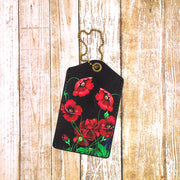 Shop Mlavi's vegan leather luggage tag for women with Ukrainian poppy flower print. Great for everyday use & a unique gift for yourself & family & friends. More Ukraine themed bags, wallets & other fashion accessories are available for wholesale at www.mlavi.com for gift shop & boutique buyers worldwide.