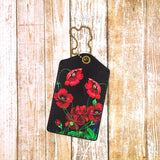 Shop Mlavi Studio's vegan leather luggage tag for women with Ukrainian poppy flower print. Great for everyday use & a unique gift for yourself & family & friends. More Ukraine themed bags, wallets & other fashion accessories are available for wholesale at www.mlavi.com for gift shop & boutique buyers worldwide.