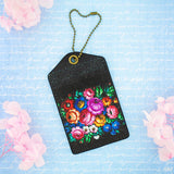 Shop Mlavi Studio's vegan leather luggage tag for women with Ukrainian flower print. Great for everyday use & a unique gift for yourself & family & friends. More Ukraine themed bags, wallets & other fashion accessories are available for wholesale at www.mlavi.com for gift shop & boutique buyers worldwide.