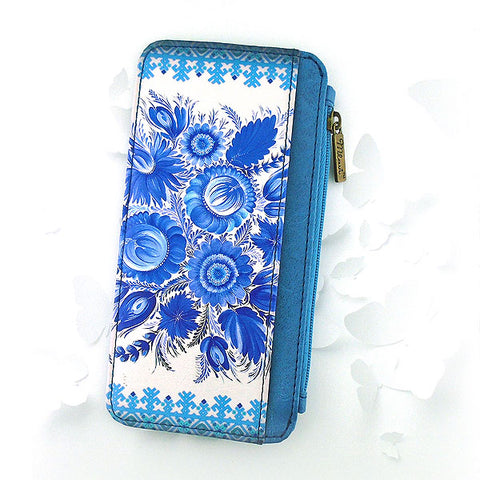 Shop Mlavi Studio's Eco-friendly vegan leather cardholder with Ukrainian Petrykivka style flower print print. It's great for everyday use & a unique gift for yourself & family & friends. More Ukraine themed bags, wallets & other fashion accessories are available for wholesale at www.mlavi.com for gift shop & boutique buyers worldwide.