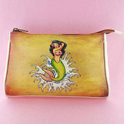 Shop online for Mlavi's Eco-friendly faux/vegan leather makeup pouch with whimsical playful tattoo style mermaid print. Great gift idea for tattoo lovers. Wholesale available at http://www.mlavi.com for gift shops and boutiques